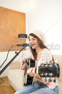 stock photo: pretty girl singing and playing guitar-Raw Stock Photo ID: 53999
