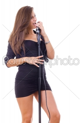 stock photo: pretty girl singing on microphone in black dress-Raw Stock Photo ID: 54000