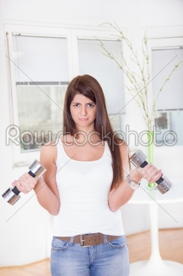 stock photo: pretty sad girl exercise with weights-Raw Stock Photo ID: 53980