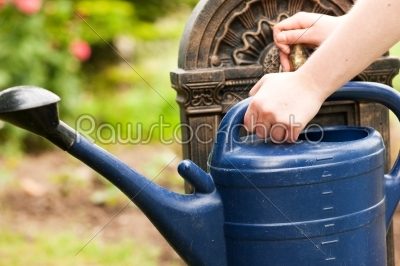 stock photo: refilling the watering pot-Raw Stock Photo ID: 50177
