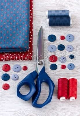 stock photo: scissors threads fabric and buttons on wooden table-Raw Stock Photo ID: 68211