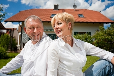 stock photo: senior couple sitting in front of their home-Raw Stock Photo ID: 50417