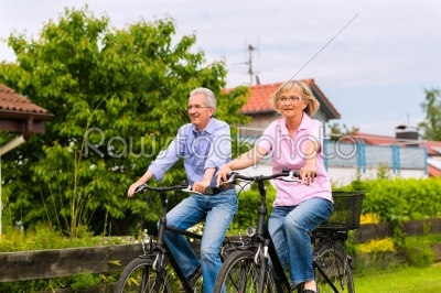stock photo: seniors exercising with bicycle-Raw Stock Photo ID: 49150