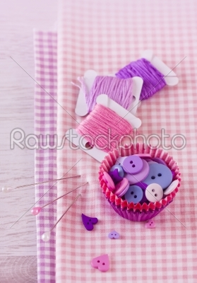 stock photo: sewing items with a check fabrics buttons thread and pins-Raw Stock Photo ID: 68469
