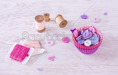 stock photo: sewing items with a check fabrics buttons thread and pins-Raw Stock Photo ID: 68470