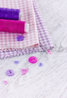 stock photo: sewing items with a check fabrics buttons thread and pins-Raw Stock Photo ID: 68472