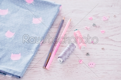 stock photo: sewing materials pencils fabric on a blue and pink color-Raw Stock Photo ID: 68406