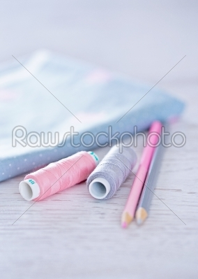 stock photo: sewing materials pencils fabric on a blue and pink color-Raw Stock Photo ID: 68407
