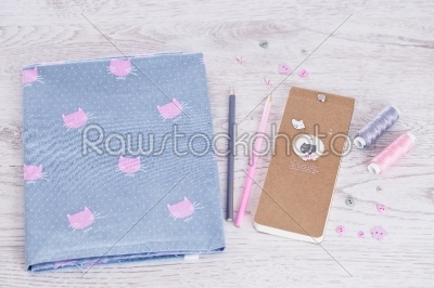 stock photo: sewing materials pencils notes fabric on a blue and pink color-Raw Stock Photo ID: 68405