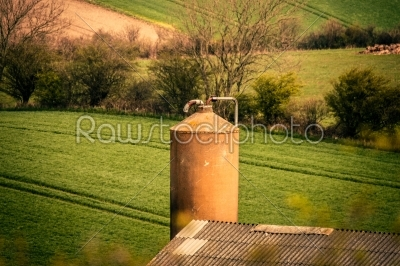 stock photo: silo storage with a field in the background-Raw Stock Photo ID: 66594