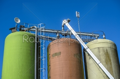 stock photo: silos on blue background-Raw Stock Photo ID: 67753