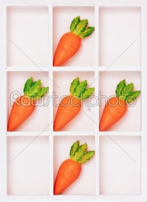stock photo: simple box with carrots on cells isolated-Raw Stock Photo ID: 68225
