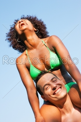 stock photo: summer bikini girl sitting on shoulders of man-Raw Stock Photo ID: 51054