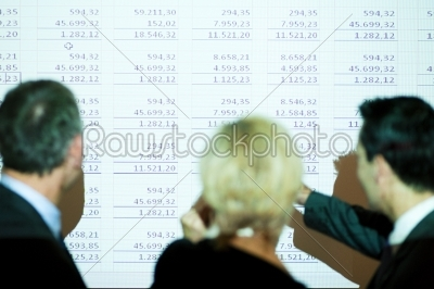 stock photo: team discussing a spreadsheet-Raw Stock Photo ID: 49949