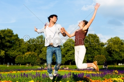 stock photo: tourist couple in city park jumping in sun-Raw Stock Photo ID: 49652