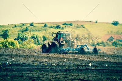 stock photo: tractor plowing an agricultural field-Raw Stock Photo ID: 66631