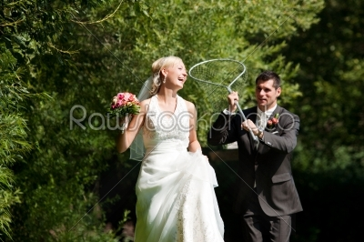stock photo: wedding  groom catching his bride with dip net-Raw Stock Photo ID: 49928