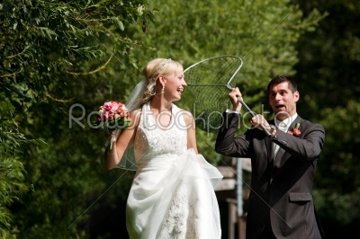 stock photo: wedding  groom catching his bride with dip net-Raw Stock Photo ID: 49929