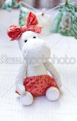 stock photo: white hippo toy with textile and sewing accessory-Raw Stock Photo ID: 68189