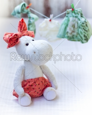 stock photo: white hippo toy with textile and sewing accessory-Raw Stock Photo ID: 68190