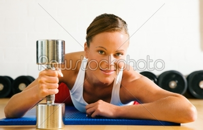 stock photo: woman with dumb bell in the gym-Raw Stock Photo ID: 49915