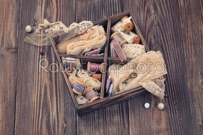 stock photo: wooden box with laces ribbons and threads-Raw Stock Photo ID: 68031