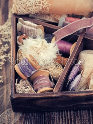 stock photo: wooden box with laces ribbons and threads-Raw Stock Photo ID: 68380