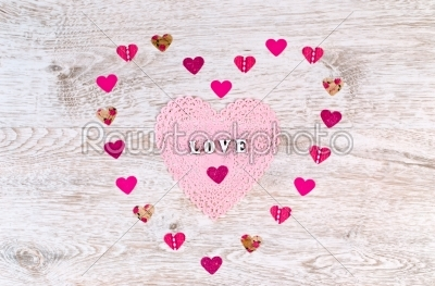 stock photo: word love with paper hearts shaped valentines day on white wooden background-Raw Stock Photo ID: 68341