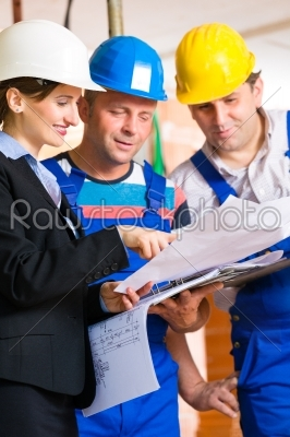 stock photo: work team on construction site controlling floor plan-Raw Stock Photo ID: 49486