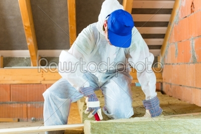 stock photo: worker cutting insulating material-Raw Stock Photo ID: 48914