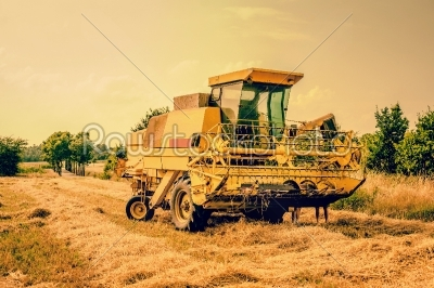 stock photo: yellow agricultural harvester machine-Raw Stock Photo ID: 66024