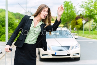 stock photo: young businesswoman calls for a taxi-Raw Stock Photo ID: 48747