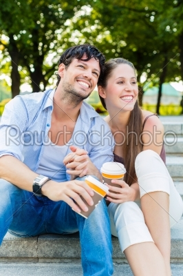 stock photo: young couple in city park drinking coffee-Raw Stock Photo ID: 49646