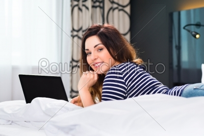 stock photo: young woman in hotel in bed with wifi and computer-Raw Stock Photo ID: 49015