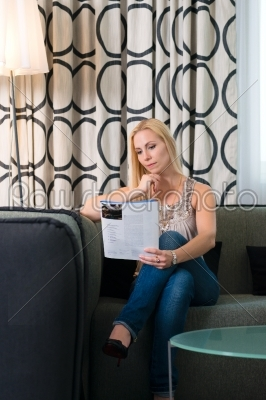 stock photo: young woman reading a magazine in hotel room-Raw Stock Photo ID: 49054